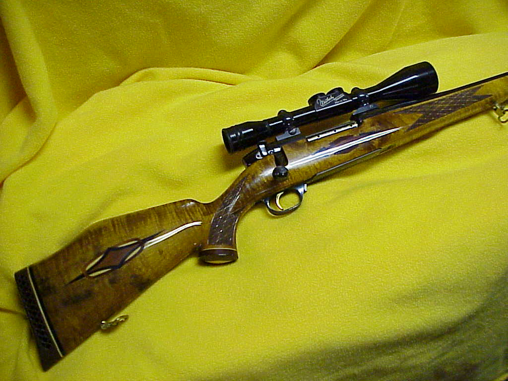 Weatherby .340 W Mag. Custom Deluxe Mk V with 2 3/4x to 10x Weatherby Scope.